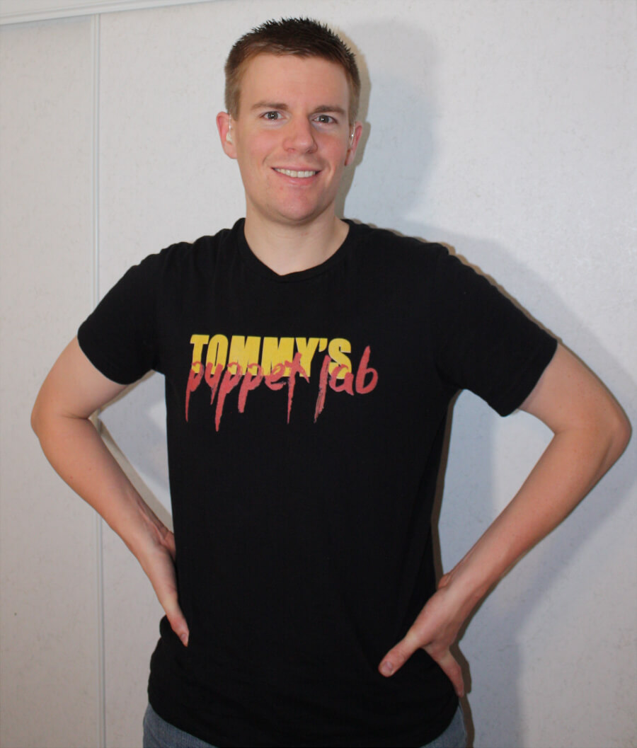 Tommy from Tommys Puppet Lab wearing his merchandise - tshirt
